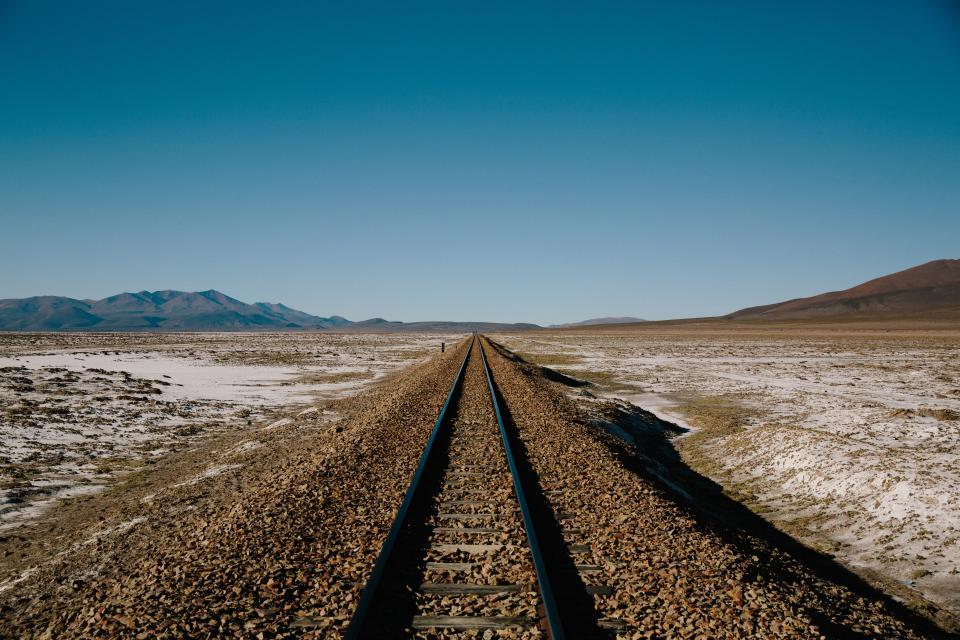 train tracks, railroad, railway, transportation, rural, blue, sky, mountains, fields, nature, landscape