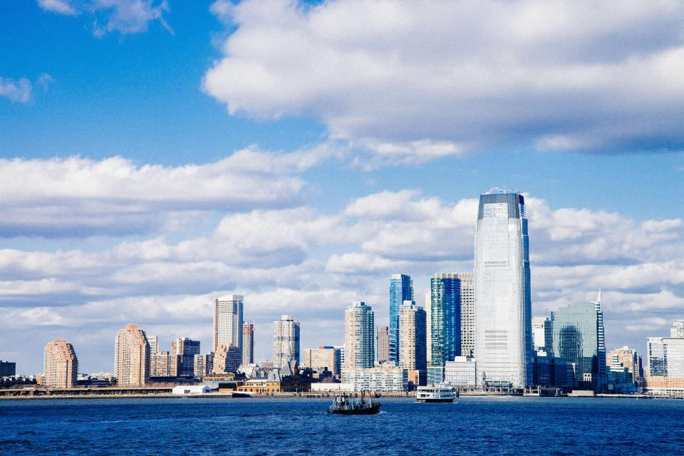 cityscape, skyline, buildings, architecture, towers, high rises, blue, sky, clouds, water, boats, ships, urban