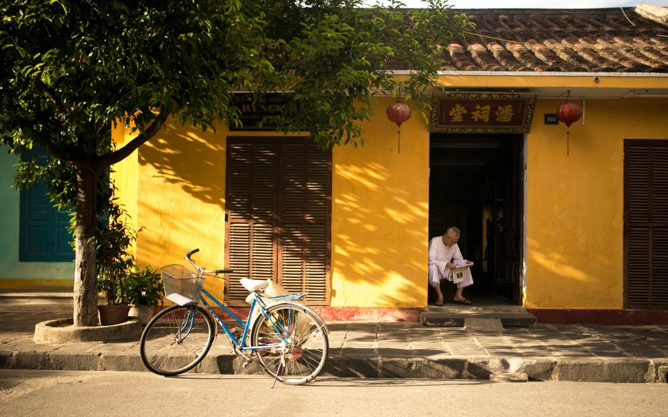 bike, bicycle, tree, stones, sidewalk, street, old man, asian, yellow, house, roof
