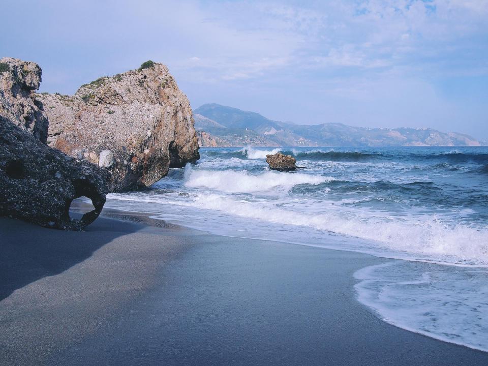 beach, sand, shore, ocean, sea, waves, water, rocks, boulders, sunshine, summer, Nerja, Spain, coast