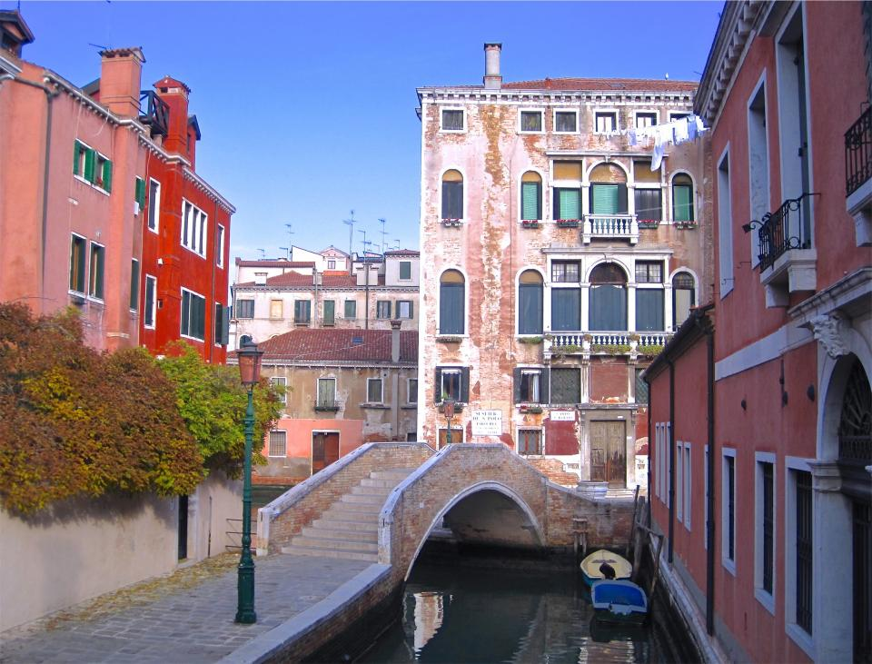 buildings, apartments, balconies, canal, water, boats, bridge, steps, cobblestone, lamp post, city