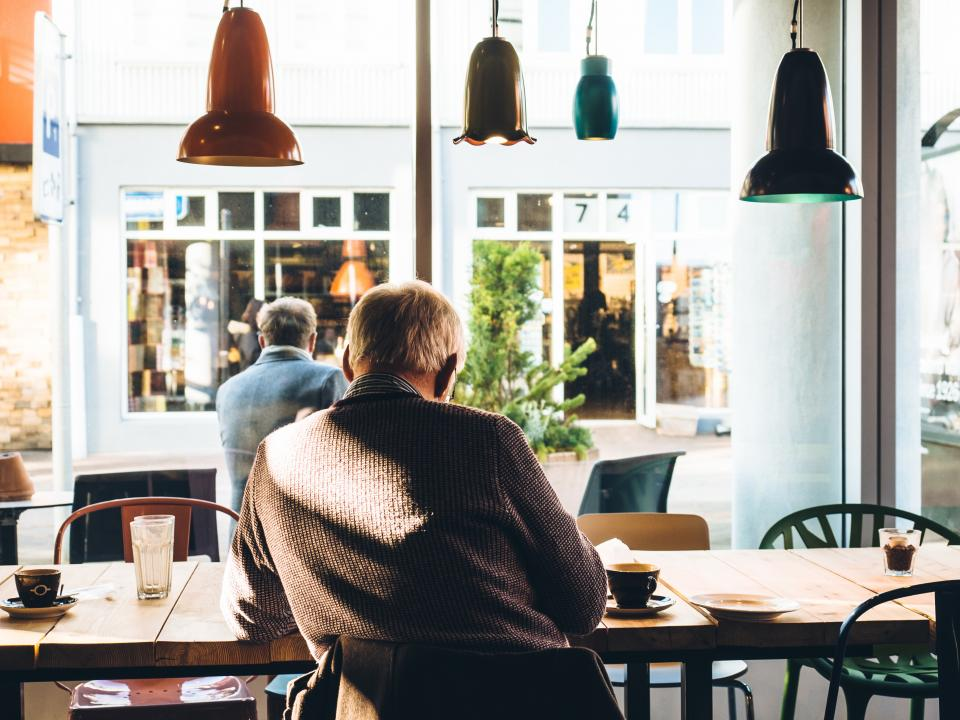coffee, cafe, shop, espresso, mocha, latte, cappuccino, table, chairs, drink, glass, food, lights, windows, reading, old man, elderly, sweater