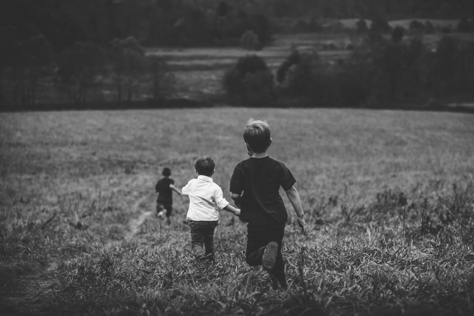 kids, children, boys, playing, running, field, fun, nature, grass, plants, trees, people, black and white