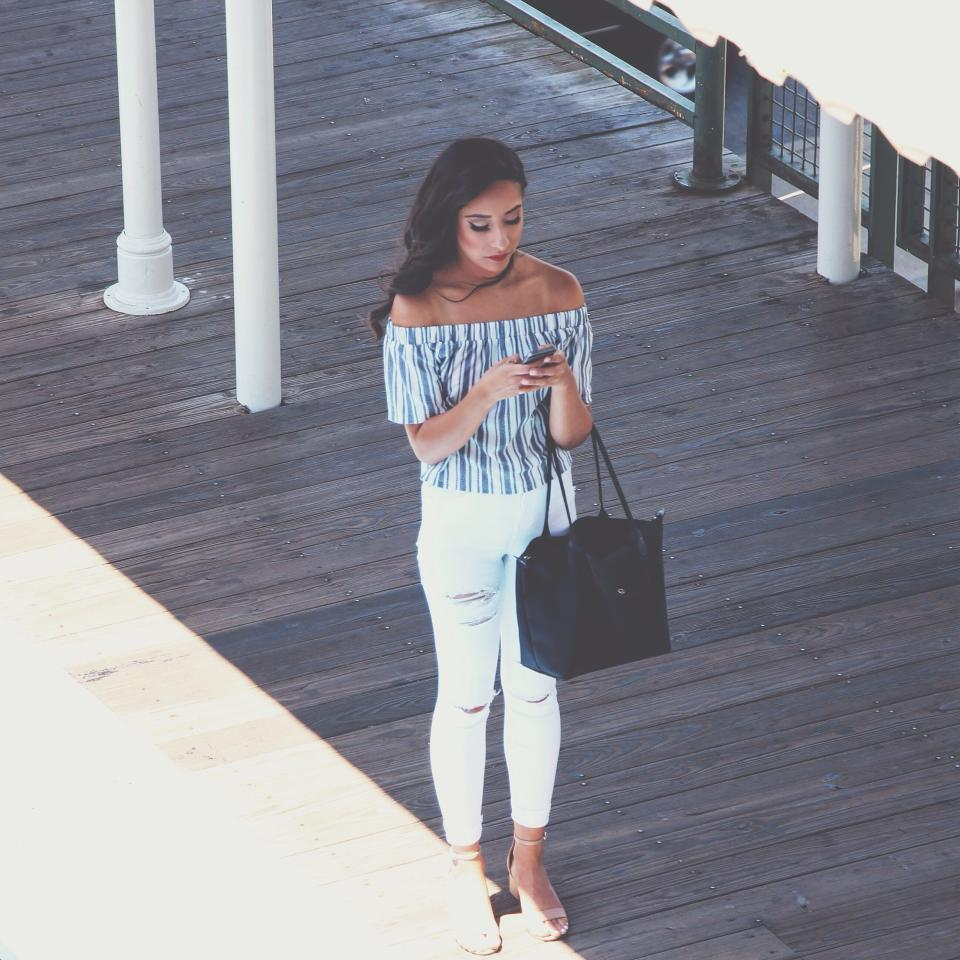 people, girl, beauty, clothing, fashion, bag, phone, texting, waiting, sunlight, sunny, shade, pole
