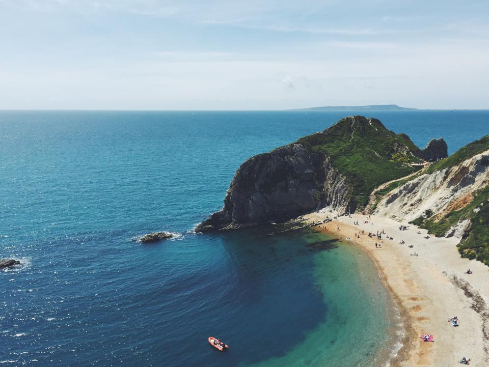beach, sand, coast, tropical, travel, vacation, blue, sky, water, boat, landscape, nature, rocks