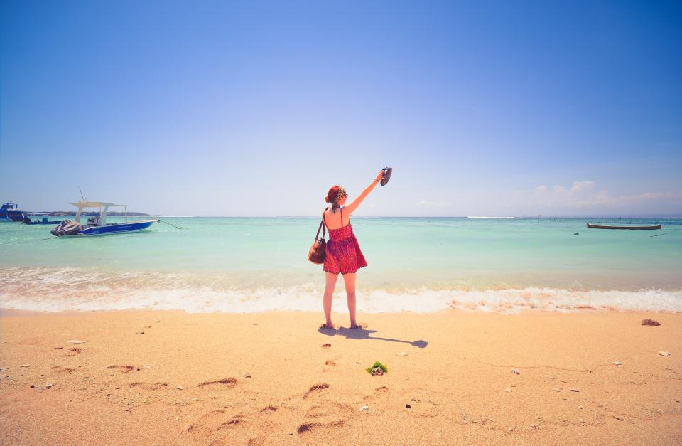 beach, sand, shore, ocean, sea, sunshine, summer, blue, sky, vacation, tropical, paradise, trip, boats, girl, woman, people, footprints