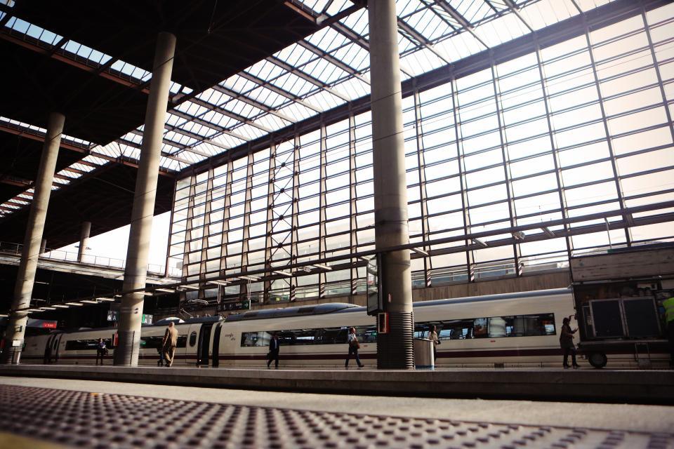 train, station, tracks, transportation, travel, passenger, walking, pedestrian, beams, pillars, windows, sunlight