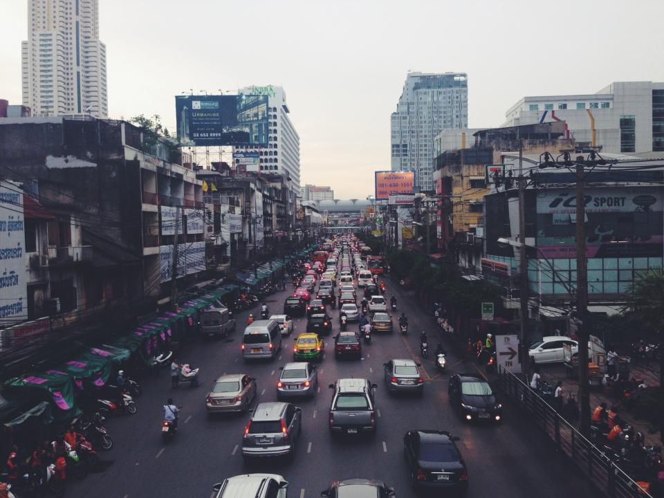cars, scooters, bikes, mopeds, traffic, busy, city, thailand, asia, buildings, stores, shops, road, street, signs, billboards