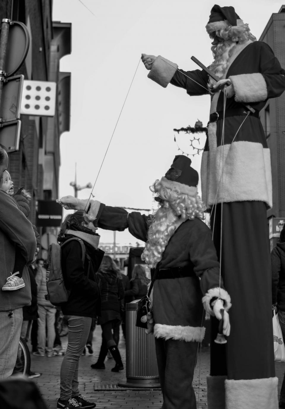 santas, marionettes, stilts, festival, parade, party, street, spectators, people, crowd, christmas