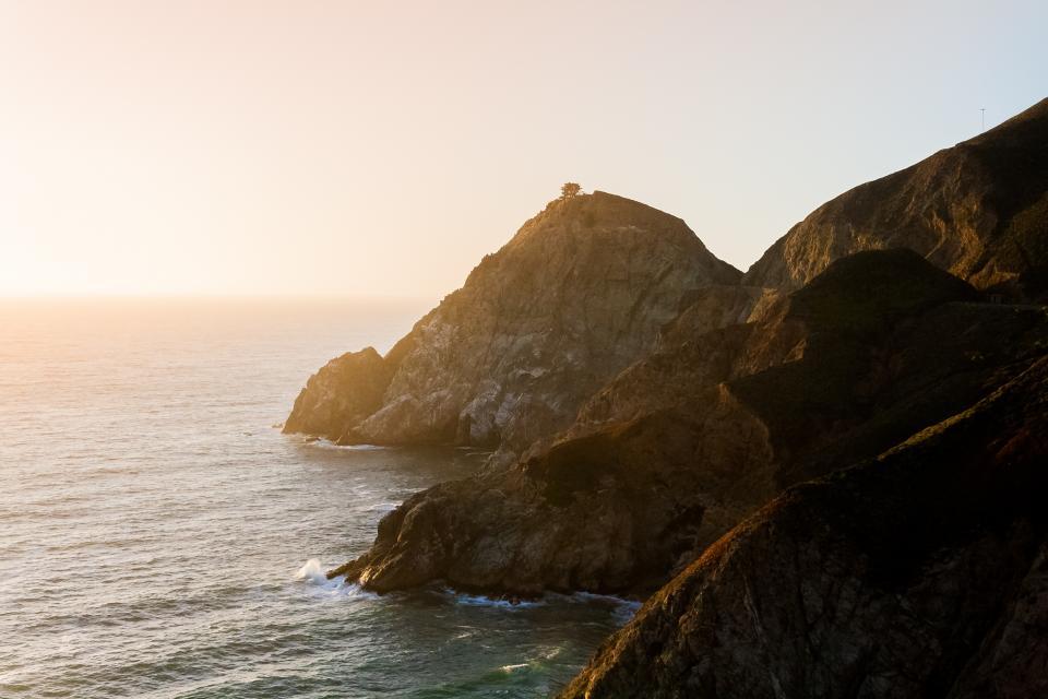 sunshine, sky, mountains, rocks, cliffs, water, coast, ocean, waves