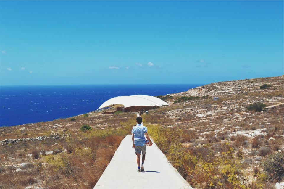 blue, sky, ocean, sea, water, guy, man, soccer ball, path, tent, plants, coast, shorts, sunshine, sunny, summer
