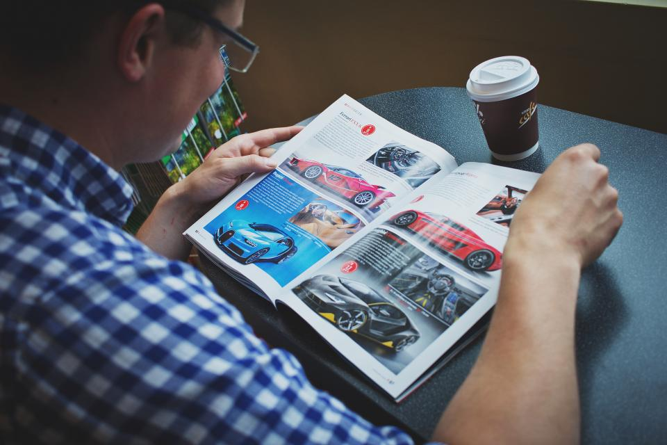 guy, man, male, people, read, magazine, cars, page, coffee, mug, table