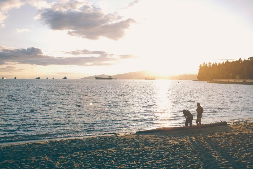 beach, sand, lake, water, sunset, dusk, shadows, people, boats, trees, sky, clouds, landscape, nature