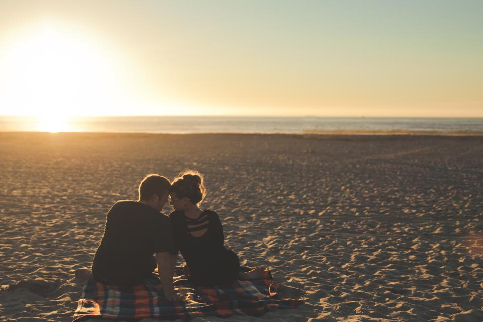 guy, man, girl, woman, people, couple, love, beach, blanket, sunset, beach, sand, ocean, sea