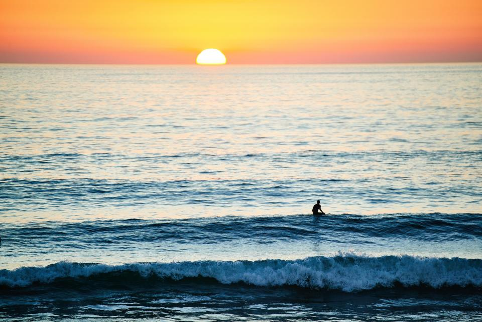 people, man, swimming, surfing, sport, sea, ocean, water, sunset, sunrise, sunshine, orange, horizon, wave