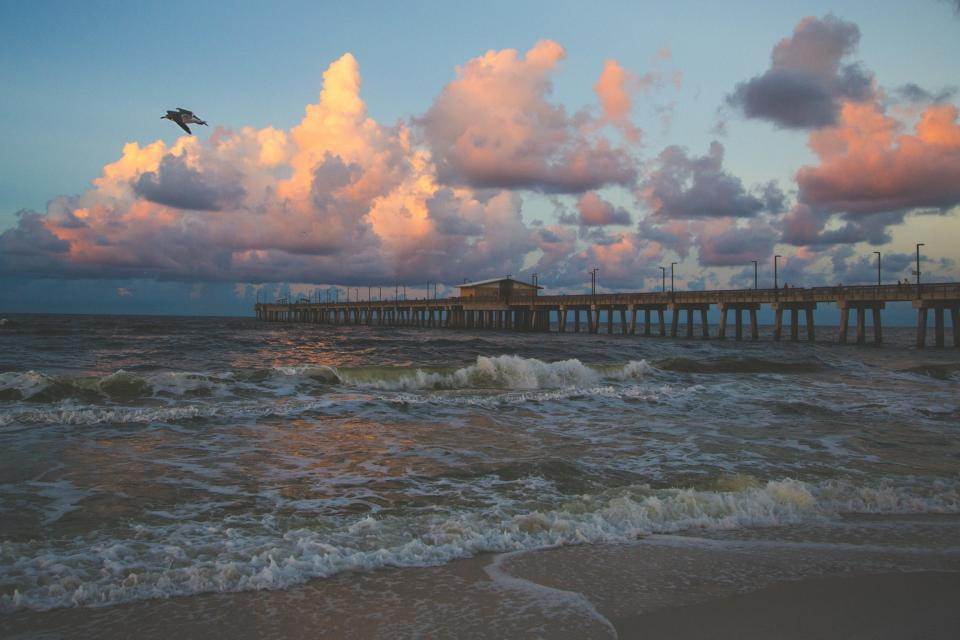 pier, ocean, sea, waves, shore, sand, beach, birds, sky, clouds, dusk, landscape