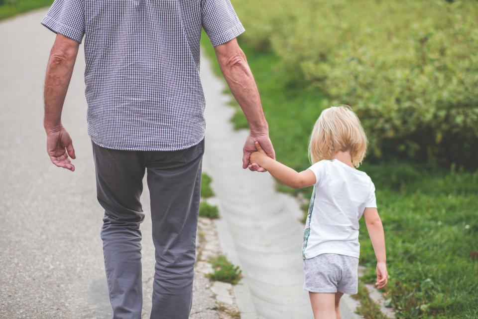 young, girl, daughter, kid, child, dad, father, grandfather, family, holding hands, walking, street, road, outdoors, grass, shrubs, people