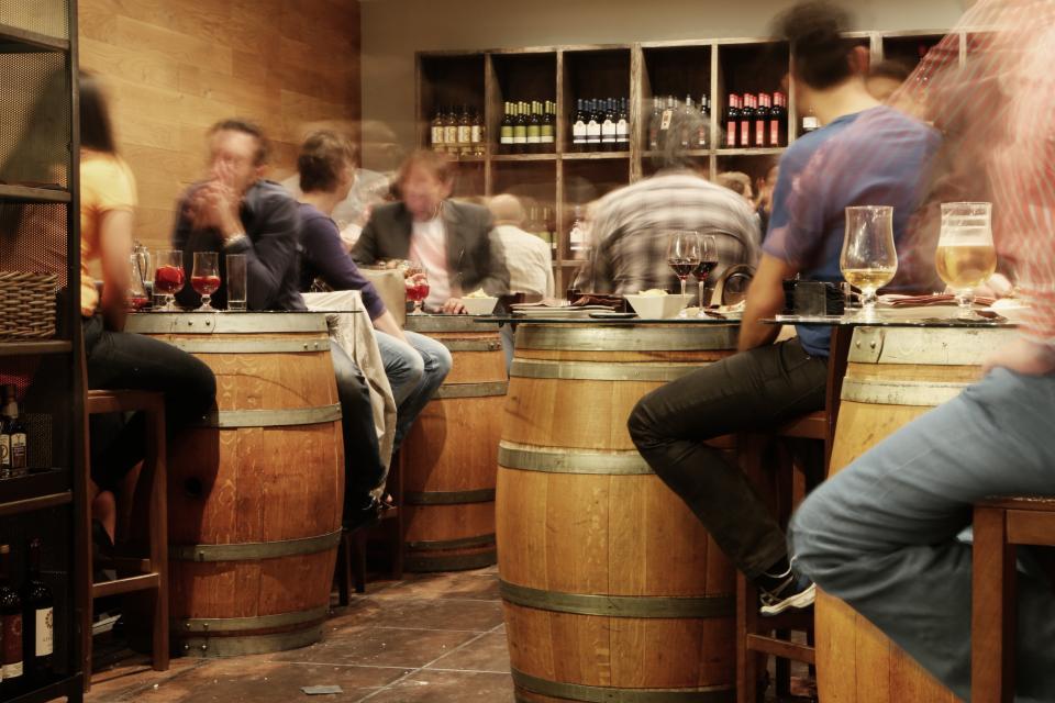 wine, beer, alcohol, bar, restaurant, tapas, snacks, food, barrels, people, eating, drinking, bottles, tiles, shelves