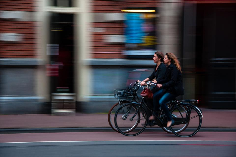 cyclists, bikers, bicycles, girls, women, woman, people, street, transportation