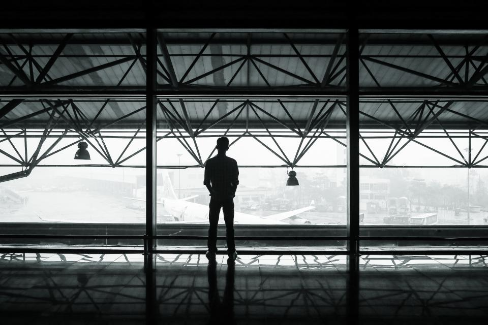 airport, airplanes, hanger, terminal, window, beams, lights, man, shadow, black and white