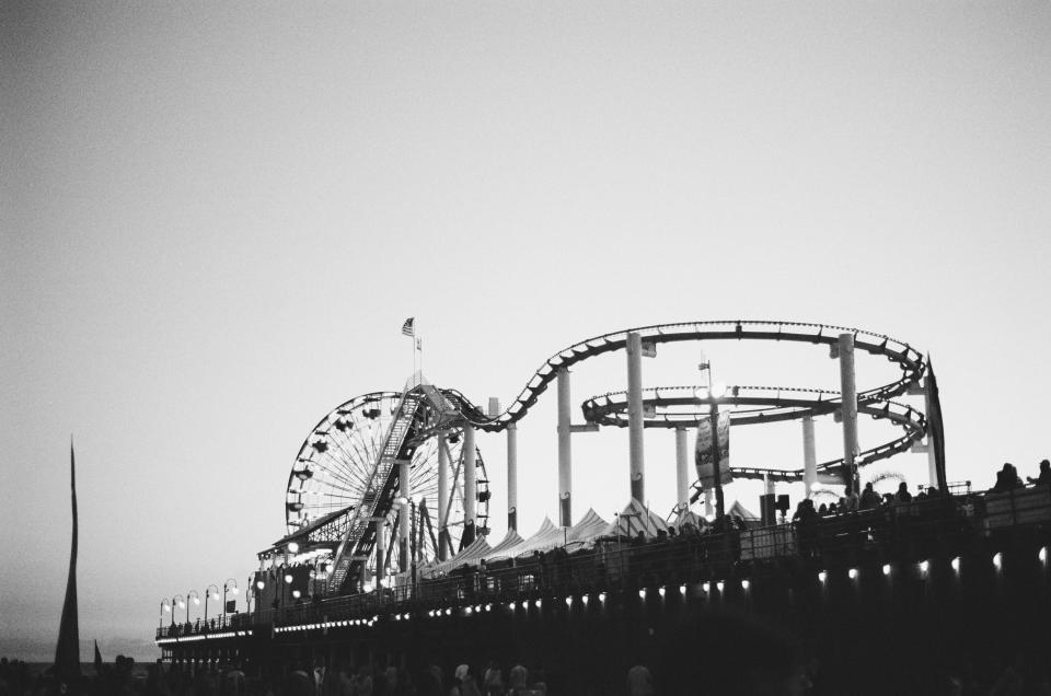 amusement park, carnival, rides, roller coaster, ferris wheel, tents, pier, people, crowd, black and white, flag, usa, fun