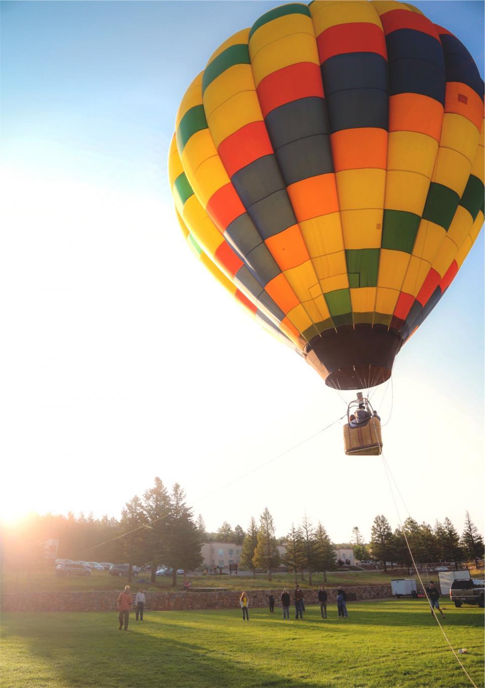 hot air balloon, grass, people