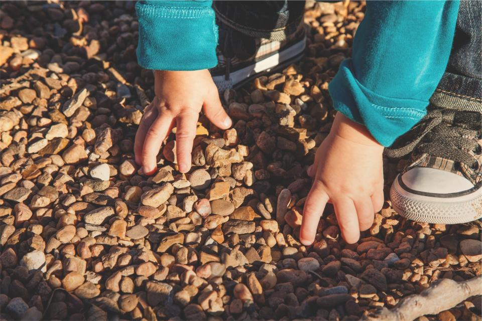 child, baby, hands, shoes, jeans, sweater, rocks