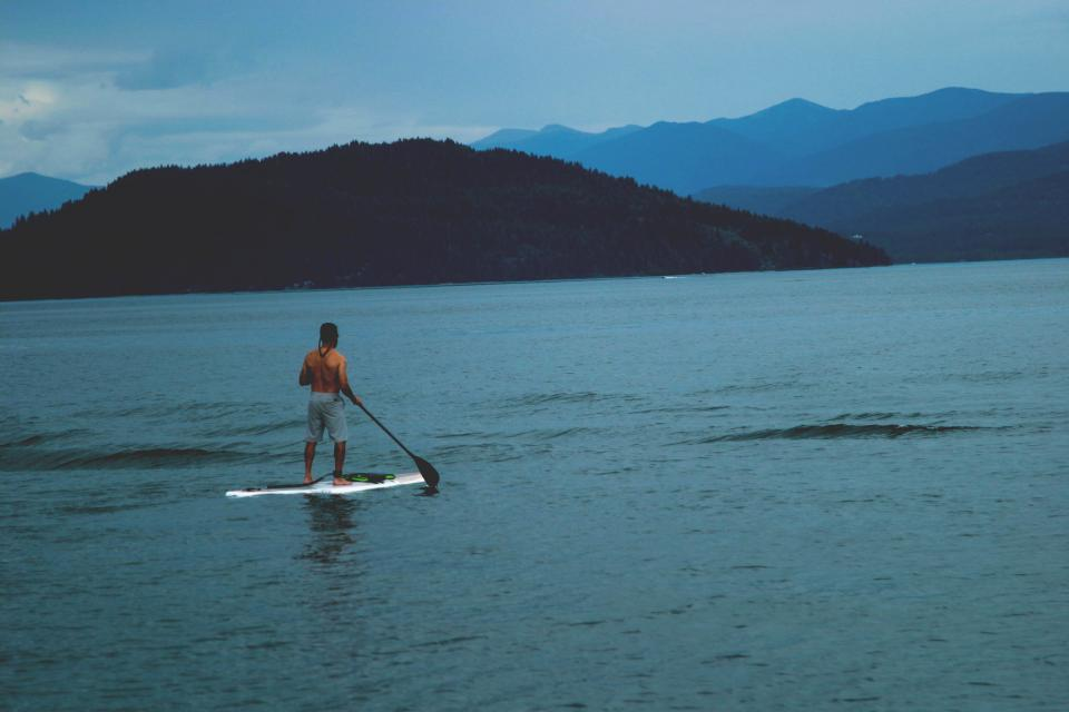 lake, water, paddle board, guy, man, people, mountains, trees, nature, landscape, blue, sky