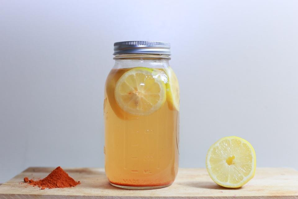 mason jar, lemons, juice, spices, cutting board