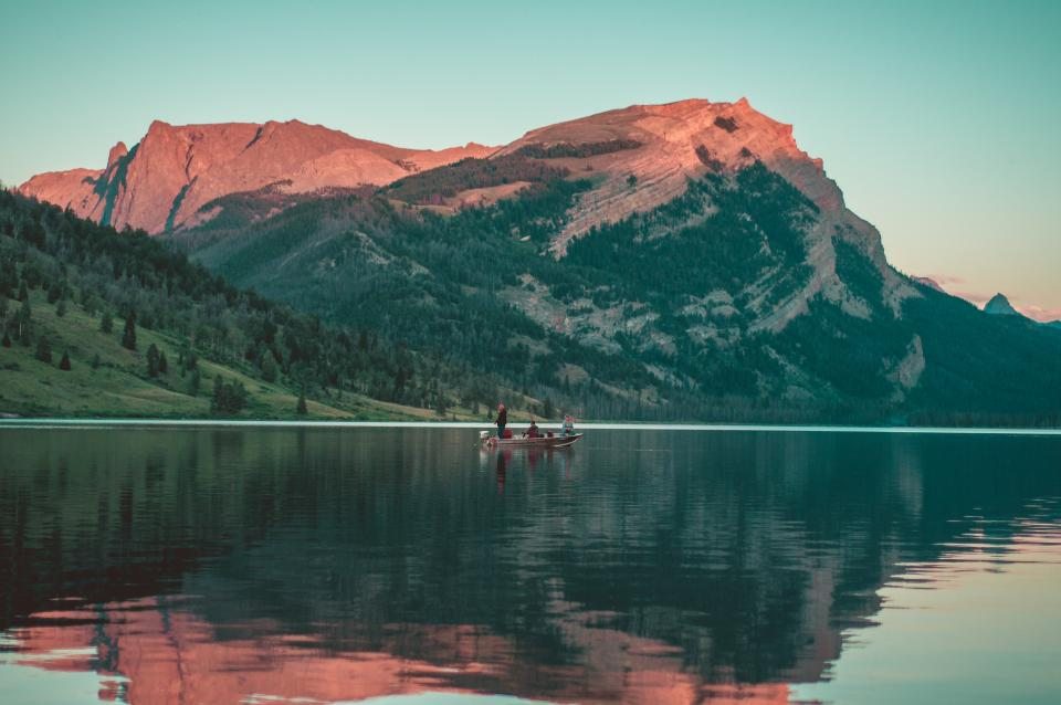 boat, lake, water, reflection, mountains, hills, cliffs, trees, landscape, nature, adventure, outdoors, people, blue, sky, sunset