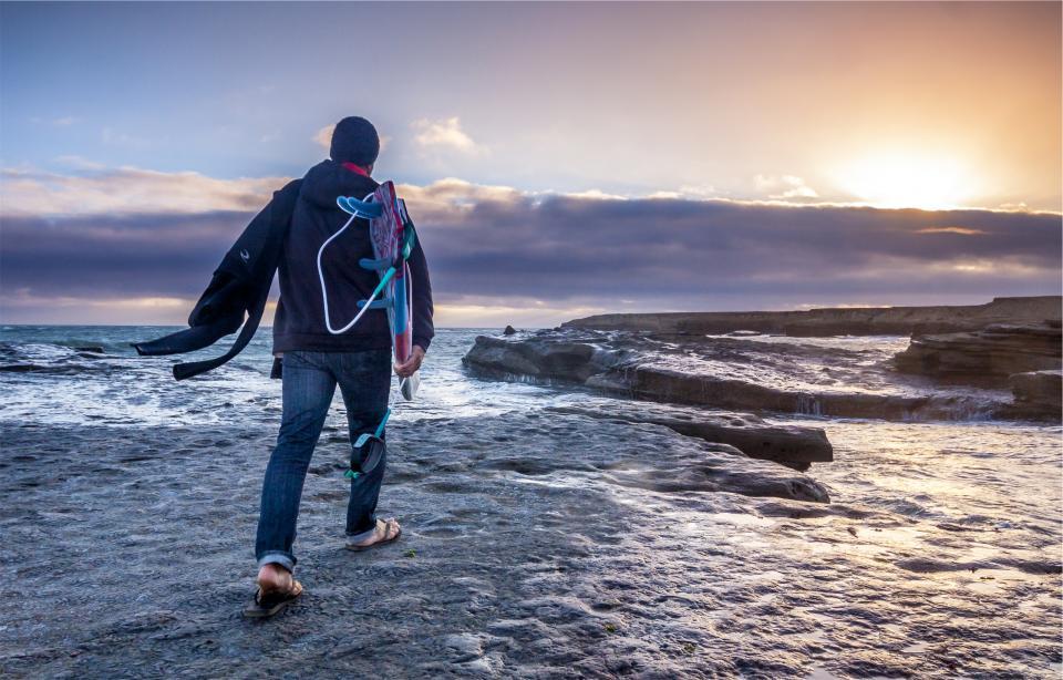 surfer, surfboard, ocean, sea, waves, water, sunrise, clouds, jeans, hat, toque, beanie, hoodie, wetsuit