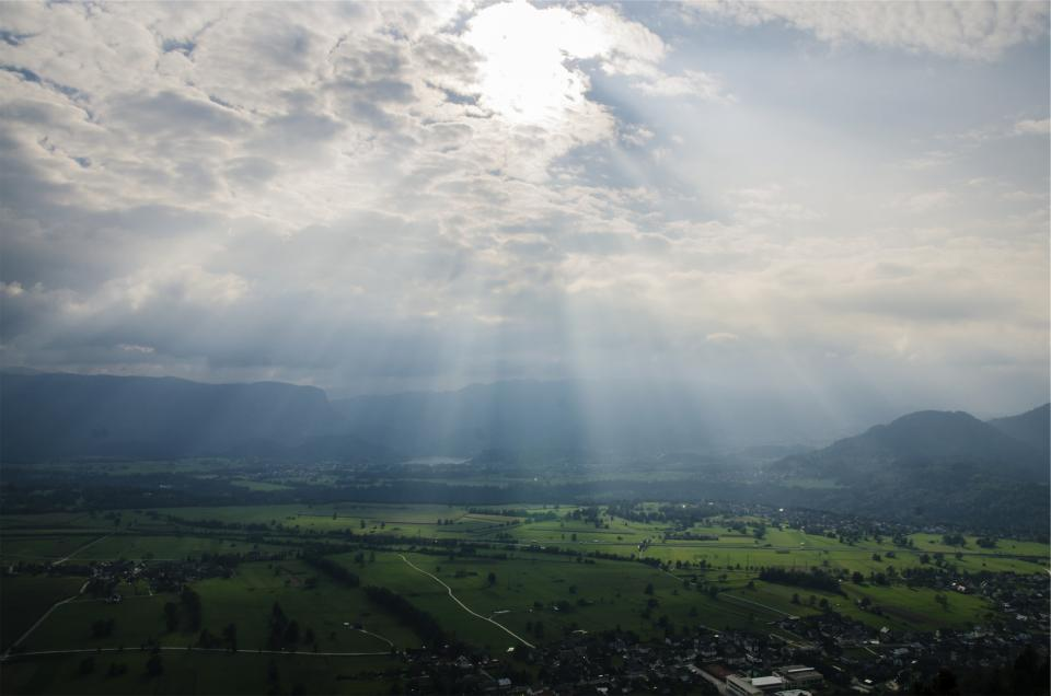sunbeams, sky, clouds, landscape, green, grass, fields, trees, mountains, rural, town, village