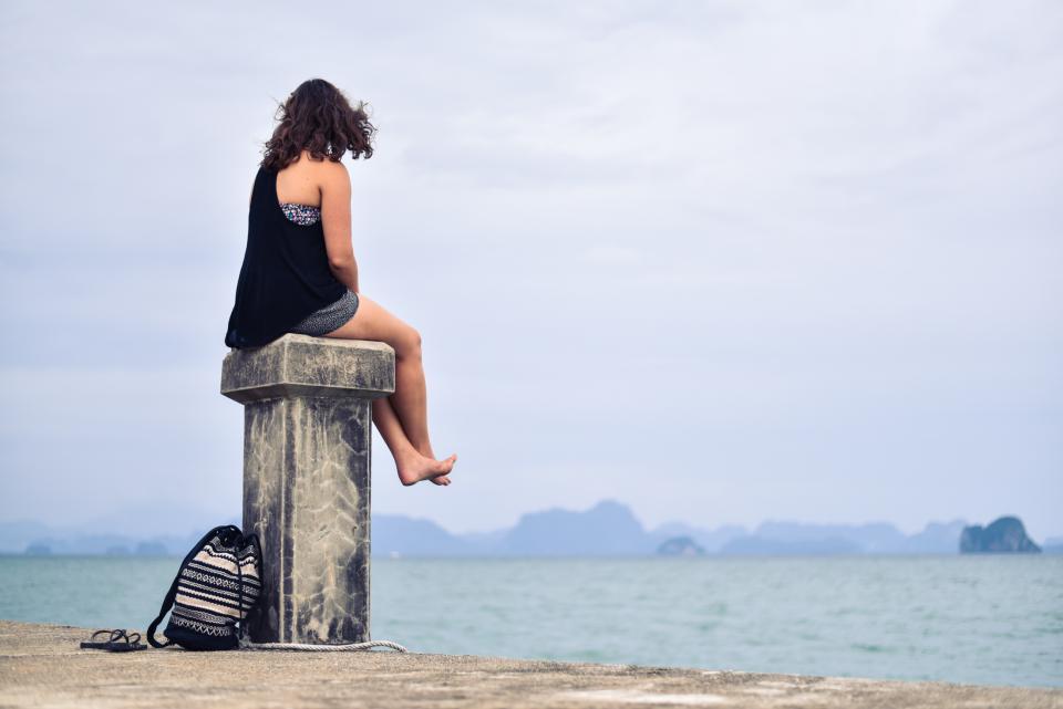 girl, woman, brunette, shorts, legs, feet, bag, sandals, dock, post, water, sea, sky, people