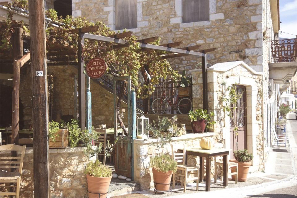 greek, restaurant, flowers, plants, pots, chairs, tables, sidewalk, entrance, stones