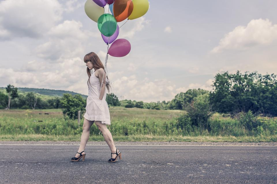 girl, woman, balloons, high heels, dress, legs, redhead, hair, walking, country, road, grass, fields, trees, green, sky, clouds