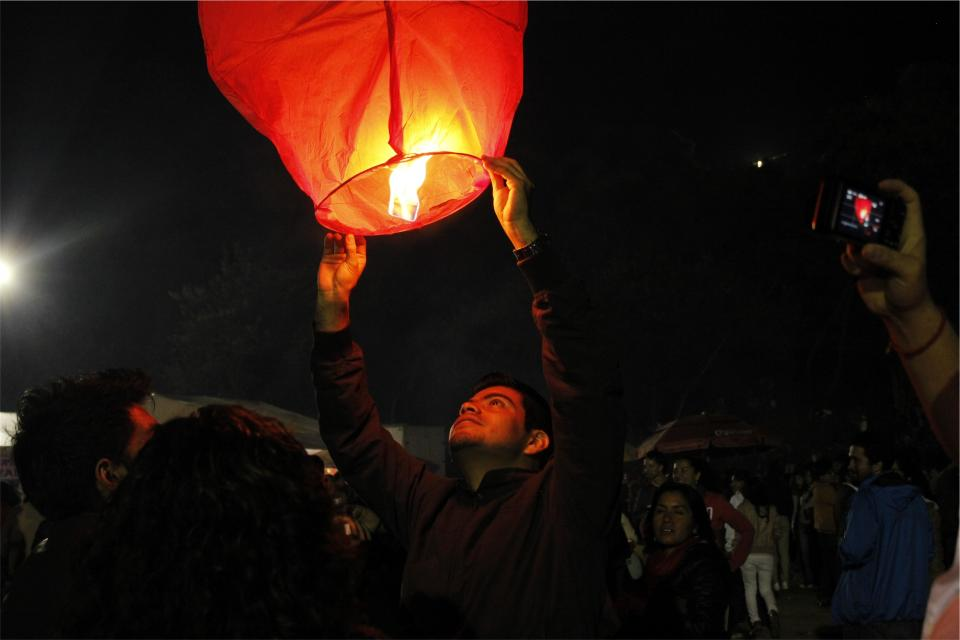 fire, lantern, dark, night, people, crowd, spectators, photographers, man, guy