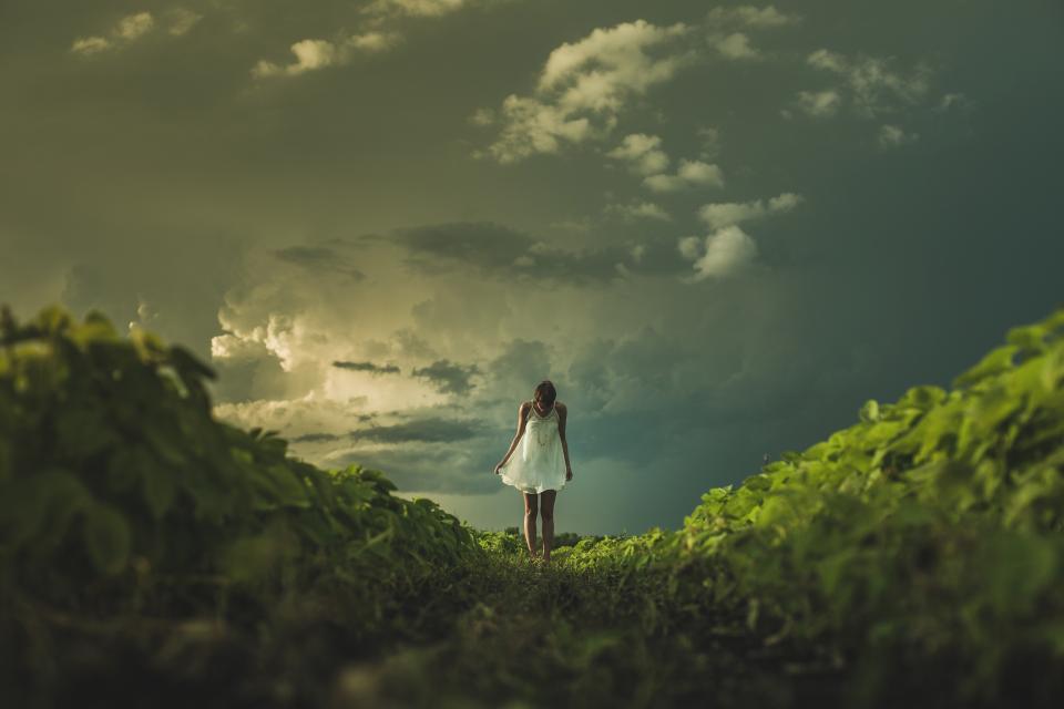 girl, woman, dress, grass, nature, landscape, sky, clouds, people, dark, storm, green