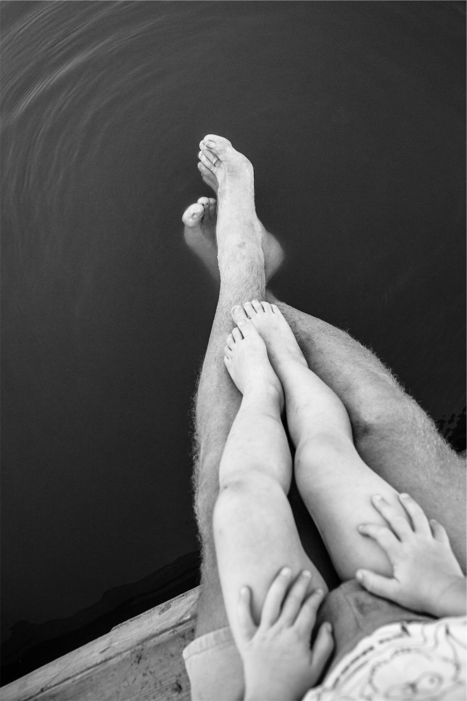 legs, feet, hands, shorts, father, child, kid, parent, water, black and white