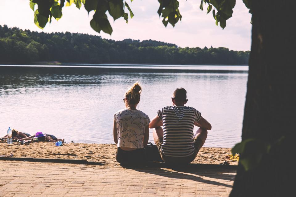 man, woman, people, couple, love, affection, date, picnic, sit, sand, bricks, floor, trees, water, lake, river, view