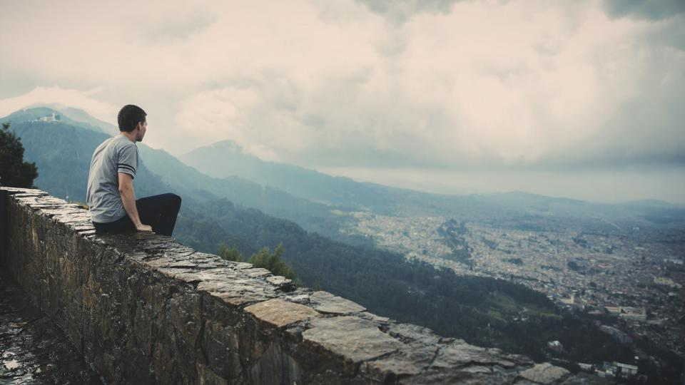 guy, looking, sitting, ledge, city, town, mountains, valleys, hills, clouds, view, people