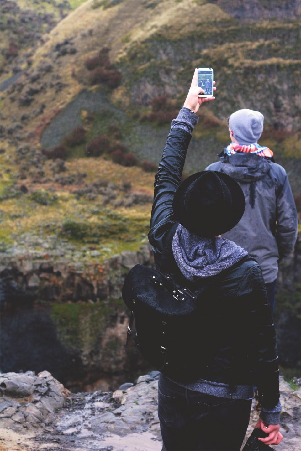 people, nature, outdoors, mobile, cell phone, picture, hat, jacket, fedora, river