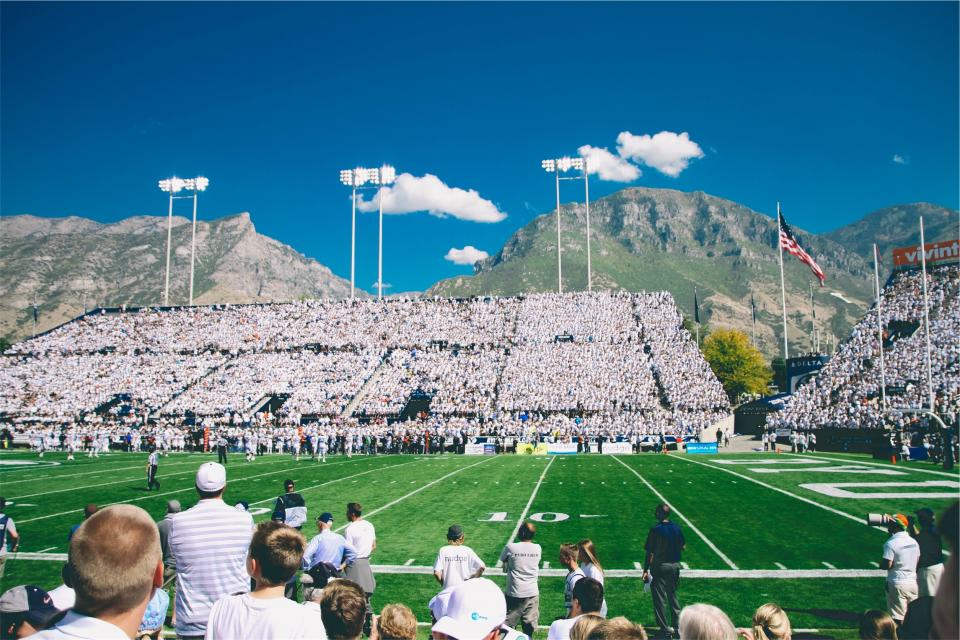 football, field, sports, stadium, spectators, crowd, american, flag, usa, united states, mountains, sky, clouds