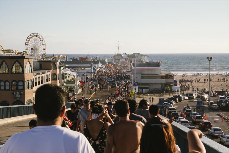 beach, sand, water, ocean, people, pedestrians, crowd, summer, ferris wheel, amusement park, fair, sunshine, cars, streets, roads