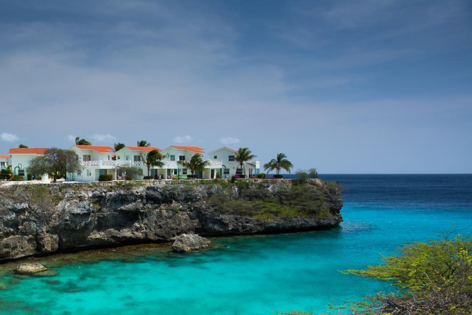 water, ocean, sea, tropical, paradise, palm trees, houses, coast, rocks, sky