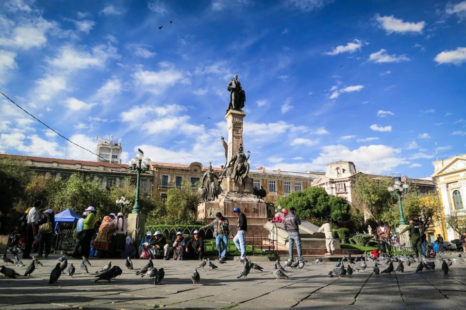 La Paz, Bolivia, landmark, monument, statue, people, pedestrians, pigeons, birds, buildings, architecture, city, urban