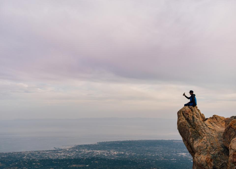 cliff, landscape, sky, clouds, city, town, coast, ocean, sea, outdoors, nature, guy, man, drinking, beer, alcohol, bottle, people