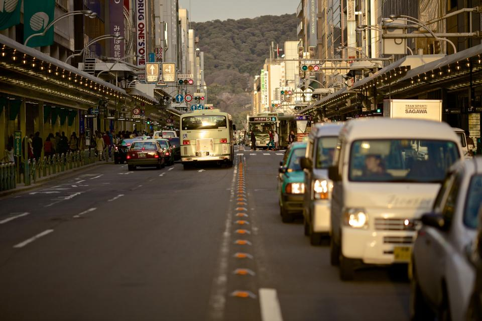 cars, busses, trucks, road, street, traffic, busy, city, buildings, stores, shops, taxis, signs
