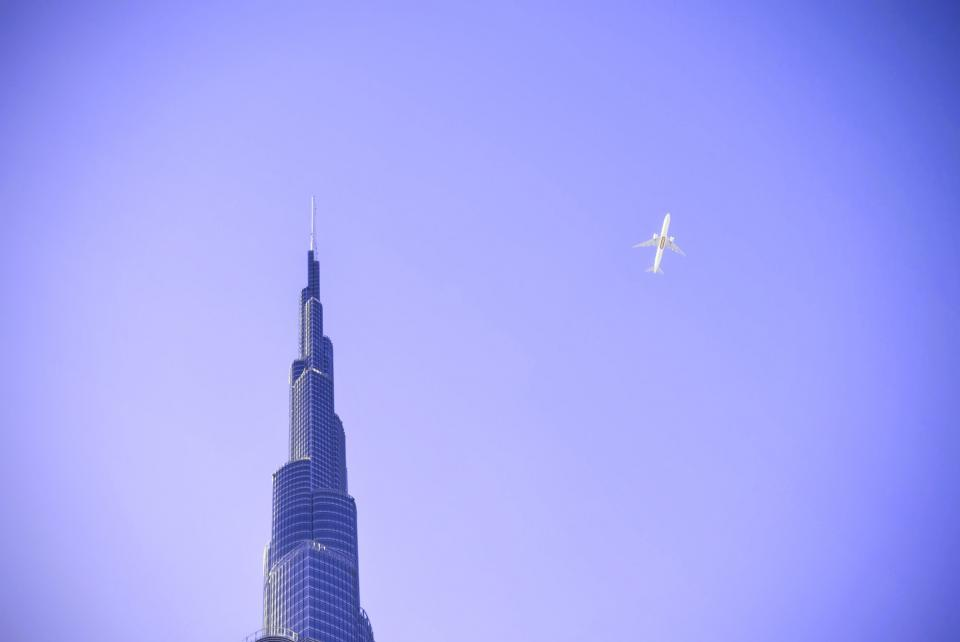 purple, sky, airplane, flying, transportation, building, architecture, tower, skyscraper