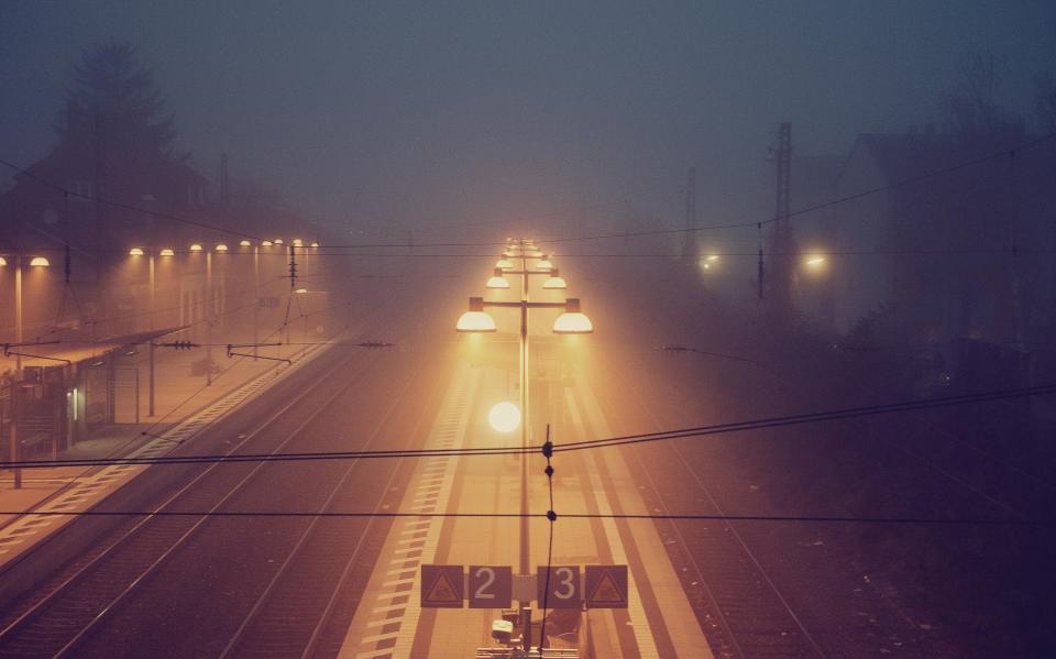 night, dark, lights, mist, fog, train tracks, railroad, railway, signs, lamp posts, evening