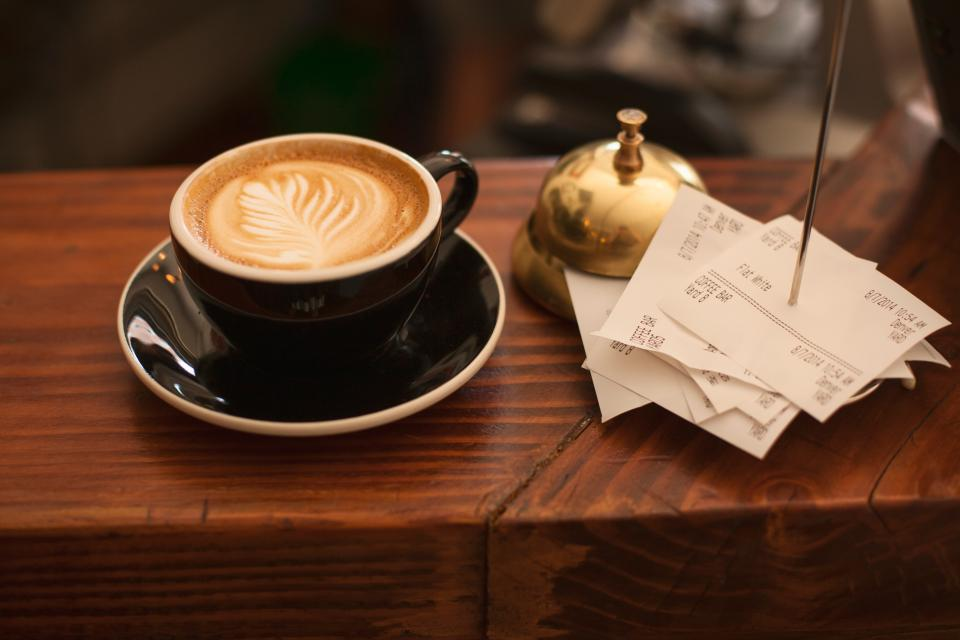 coffee, cafe latte, cappuccino, cup, shop, receipts, paper, bell, gold, wood, table